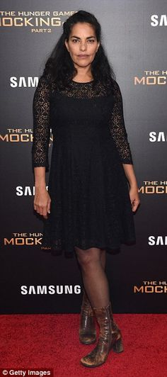 Edgy and interesting: Sarita Choudhury showed her edge in a black lace dress with rugged b...