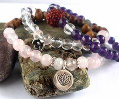 Custom mala stack with amethyst, rose quartz and clear quartz by jewelsofsaraswati.com. Yoga jewelry!
