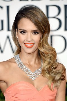 Jessica Alba is the reason why ombre hair will never fade out of style! We also love the matte orange lipstick paired with her peach dress.