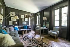 black lacquered sitting room with the velvet sofa.