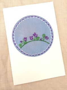 A Sweet Violet padded embroidered card on over-dyed fabric for a February birthday. x Made in a white card. Also suitable for Mother's Day or Easter. A real keepsake Look for February bracelet too! Bear Costume, February Birthday, Sweet Violets, Cross Stitch Cards, Mother's Day Diy, Gift Guide, My Design, Outdoor Blanket, Easter