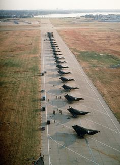 F-117A Stealth Fighters from the 37th TFW, Tonopah Test Range, NV, line the runway after arriving for an overnight stay while deploying to Khamis Mushayt, Saudi Arabia during Operation Desert Shield.