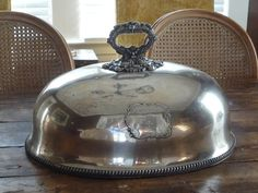 Check out this item in my Etsy shop https://www.etsy.com/listing/268256706/antique-english-silverplate-food-dome