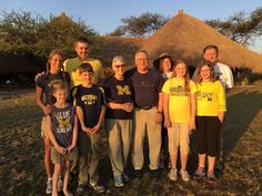 In celebration of their 50th wedding anniversary in the First Congregational Church of Ann Arbor, Perry O. Ballard Jr., '66, MA'67, and wife L. Annette, '66, took their entire maize and blue-decked family on a safari in Tanzania. Back row: Becky Bates Ballard, Perry O. Ballard III, '98; Lesli A. Ballard, '92, MD'95, Christopher Ballard, '89, JD'92; Front row: Annette and Perry (center), flanked by future Wolverines: Alina, Jackson, Katie, and Clara