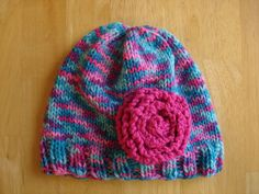 Cotton Candy Hat, needle knit, used Red Heart Super Saver: Bon Bon, Red Heart shocking pink for flower