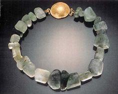 rough emeralds - 22 k gold work - handmade by Michele Delville.
