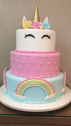 A rainbow cake is fun to look at and eat and a lot easier to make than you might think. Here's a step-by-step guide for how to make a rainbow birthday cake. Unicorn Themed Birthday, Rainbow Birthday, Birthday Cake, 5th Birthday, Cupcakes, Cupcake Cakes, How To Make A Unicorn Cake, Bolo Fack, Savoury Cake