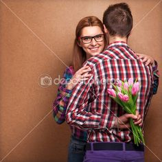Young couple in love holding a bouquet of tulips. — Stock Image #40385039