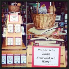 A very literate baby in a basket reads Poe in a Fikry display @bookfrogbooks
