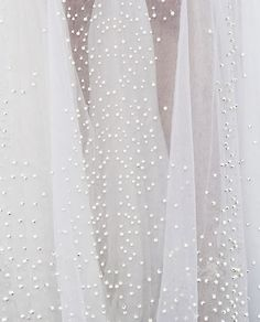 pearls hand-sewn on a givenchy haute couture gown which took a total of 8 months to complete