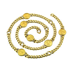 A DIAMOND AND GOLD COIN NECKLACE, BY BVLGARI  Set with six sculpted gold coins, each within an 18k gold surround, flanked on either side by a circular-cut diamond and gold half hoop, to the gold link chain, 38 ins. Signed BVLGARI, Roma, Italy $278,500.00