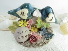 Possible Cake Topper?? Has butterflies to match the Bridesmaids dresses AND lovebirds? Perfect!!