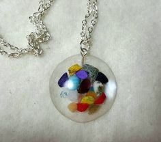 Check out this item in my Etsy shop https://www.etsy.com/listing/238222347/mixed-gemstones-in-resin-necklace