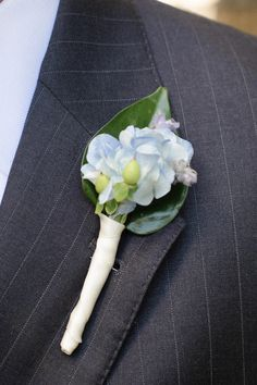 Kevin's wedding boutonniere was blue hydrangea backed with a green leaf, and it was wrapped