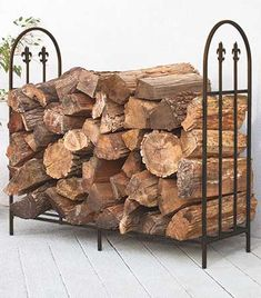 Keep your firewood off the ground with this attractive Fire Log Storage. This metal rack features highly decorative end panels styled like a traditional iron fe