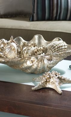 The Silver Clam Shell Display imparts an upscale coastal look as a coffee or dining table centerpiece.