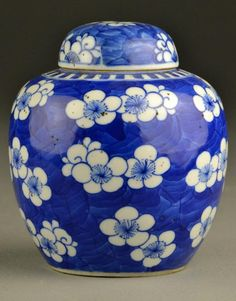 "Chinese Qing Blue & White Porcelain Lotus Jar  Having a blue ground decorated with white lotus blossoms and tendrils, having a four character seal mark in underglaze blue, measures 6""H, circa late 19th century"