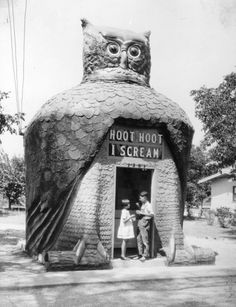 1920s - View showing a boy and girl enjoying Hoot, Hoot ice cream in front of Hoot Owl Café. I Scream Hoot Owl Cafe was in the shape of an owl. The head rotated; the eyes, made from Buick headlamps, blinked; the sign: Hoot Hoot, I Scream, used elements of a theater marquee. For over 50 years, Tillie Hattrup ran this refreshment spot designed and built by her husband, Roy in 1926-27. It was originally on Valley Boulevard, then moving to 8711 Long Beach Boulevard, before being demolished in…