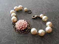 Fits the colour scheme well! - Vintage Pink Flower and Cream Pearls Bridal Bracelet, Antique Gold Brass.