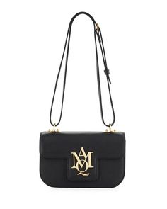 """Alexander McQueen pebbled calfskin shoulder bag. Golden hardware. Adjustable shoulder strap can be doubled. Flap top with with metal logo plaque; snap closure. 5.1""""H x 8.5""""W x 3.4""""D. Made in Italy."""