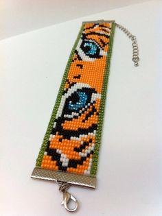 Tiger Bead Loom Bracelet by Beadalilmore on Etsy. Bead Loom Bracelets, Beaded Bracelet Patterns, Jewelry Patterns, Seed Bead Patterns, Peyote Patterns, Beading Patterns, Bead Loom Designs, Motifs Perler, Beaded Animals