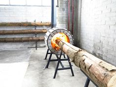 """This Ridiculous Stove Can Burn an Entire Tree Trunk, will make """"Om Nom Nom"""" noises when it's lit 
