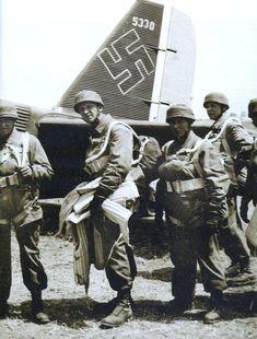 Fallschirmjäger of 2nd Fallsch.San.Abt 7 before embarking into a Ju-52 at the beginning of the Battle of Crete, May-June 1941.