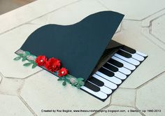 great take on a handmade piano card .. like the column of flowers too ...