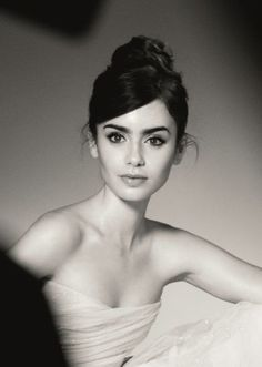 Lilly Collins looks like Audrey Hepburn!  Beautiful :)