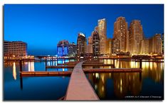 Dubai — JBR Gold. Jumeirah Beach Residence, a huge residential complex that stretches on almost 2kms. This shot was taken this evening 15 minutes after sunset, from a new marina under construction, hence the absence of boats. ♥ REPIN, LIKE, COMMENT & SHARE! ♥