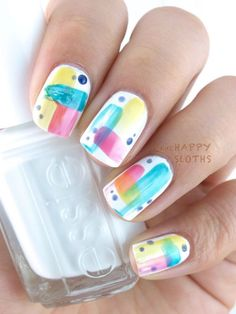 Abstract designs will surely look great with watercolor nail art. Start with a plain white polish as base and choose three or four colors that you can use for the design. You can also add random paint droplets for effect. source