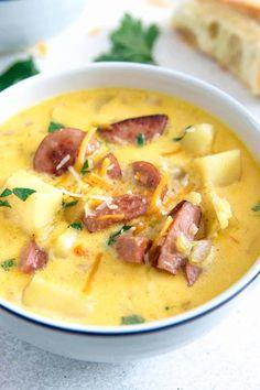 Cheesy Potato Kielbasa Soup The Thirsty Feast Kielbasa Soup, Kielbasa Sausage, Sausage Soup, Cheesy Potato Soup, Cheesy Potatoes, Baked Potatoes, Slow Cooker, Fall Soup Recipes, Soup Appetizers