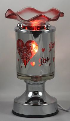 Love Burner Metal Tart Wax Burners  Turns off and on by touch, electric and comes with three different levels (low,med,high)that allow you to control the amount of scent as well as light. Check out SonShine Candle on Facebook to see more burners. Located in  Terrell,TX will ship   www.facebook.com/SonShineCandleTarts