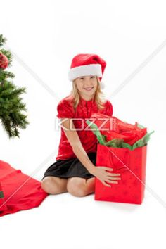 smiling young girl with her christmas gift - Portrait of a smiling young girl with her christmas gift, Model: Shania Chapman - Agent is Breann at MMG. breann@nymmg.com