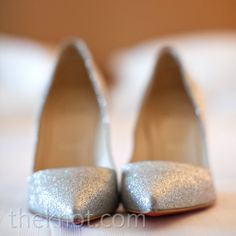 Silver Glitter Pumps- play off the sparkly details of your dress with glittery silver heels. photo by: Leigh Miller Photography Shoes: Christian Louboutin