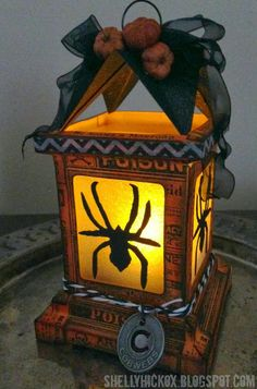 Stamptramp: Halloween Luminary Tutorial using the Sizzix Luminary die and Tim Holtz stamps, inks, Mini Spider die, and idea-ology.  Tutorial.  Can change colors and die cuts and use for other holidays/seasons.