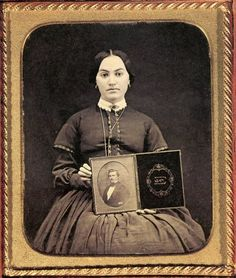 I adore this Momento Mori. She has brought her husband (I assume) into her photo by holding what appears to be a daguerreotype photo to the camera. Wonderful. ca. 1850