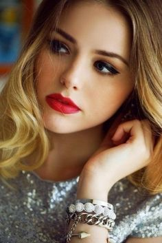 Love the look of red lipstick and winged eyeliner.