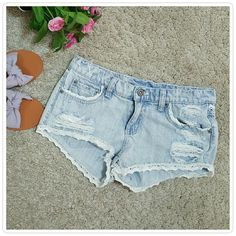 """SALE LF CARMAR Distressed Cutoff Shorts FINAL PRICE UNLESS BUNDLED Adorable light wash denim short - shorts. Features crochet trim detail on hem, front pockets and back. Purposely distressed  for that perfectly undone look. In excellent pre-loved condition. Waist 15"""" LF Shorts Jean Shorts"""
