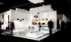 Nice exhibit/booth. The hanging panels for the type really make the space.