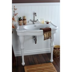 This wall-mount pedestal sink features an elegant vitreous china construction that is stain-resistant, easy to clean and germ-resistant. This bathroom sink features a traditional styling for a classic bathroom decor.