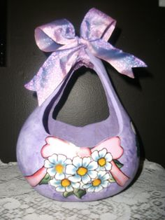 Here you will find a one of a kind Handpainted Easter Basket made from a gourd. This is a gourd that has been cut then sanded, painted and sealed. Bouquet of flowers on both sides and bunnies on both sides.