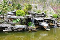 Chinese Rockery Garden With Pond And Waterfall Stock Photo, Picture And Royalty Free Image. Image 9355790.