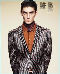 Mihai Bran has a houndstooth moment in a Reporter jacket and Lardini foulard.