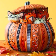 This DIY Halloween project puts a spin on the usual carved pumpkin! Miniature kitten pumpkins peek out from a hollowed out pumpkin for a sweet decoration. (via @ALL YOU Magazine www.allyou.com)