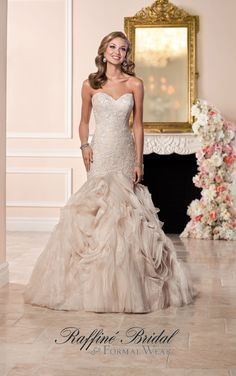 Stella York #6285 - This lace and Regency organza fit and flare wedding dress from Stella York features a beaded sweetheart neckline that cuts just below the hip into a swirling textured skirt.