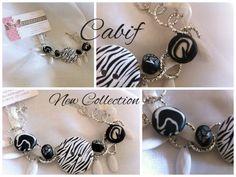 Bracciale in bianco e nero zebrato fimo ciondoli di Le idee di Cabif su DaWanda.com