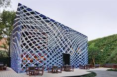 Designed by Rojkind Arquitectos, the two perforated steel templates that wrap the Tori Tori Restaurant and Lounge give the flat façade a three-dimensional effect.
