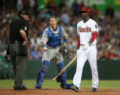 The Diamondbacks' Didi Gregorius, right, walks away after he was called out by umpire Tim Welke, left, and the Dodgers' catcher A.J. Ellis exchange balls during the Major League Baseball opening game between the Los Angeles Dodgers and Arizona Diamondbacks at the Sydney Cricket ground in Sydney, Saturday, March 22, 2014. (AP Photo/Rick Rycroft)