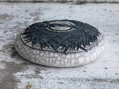 Ceramics by Patricia Shone at Studiopottery.co.uk - Targue, 'in the protection of the land' 2013. Earthenware ceramic, raku fired 12x44x44cm. image by Shannon Tofts